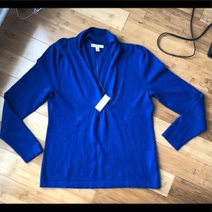 Brand new with tags. Royal blue. Size large.